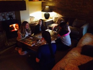 Guests share a game of 'Horseopoly' after dinner.