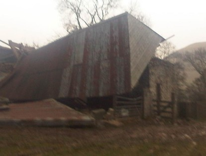 OLD BARN'S ROOF HAS BLOWN OFF!